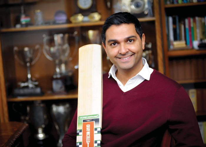 Wasim Khan holding cricket bat