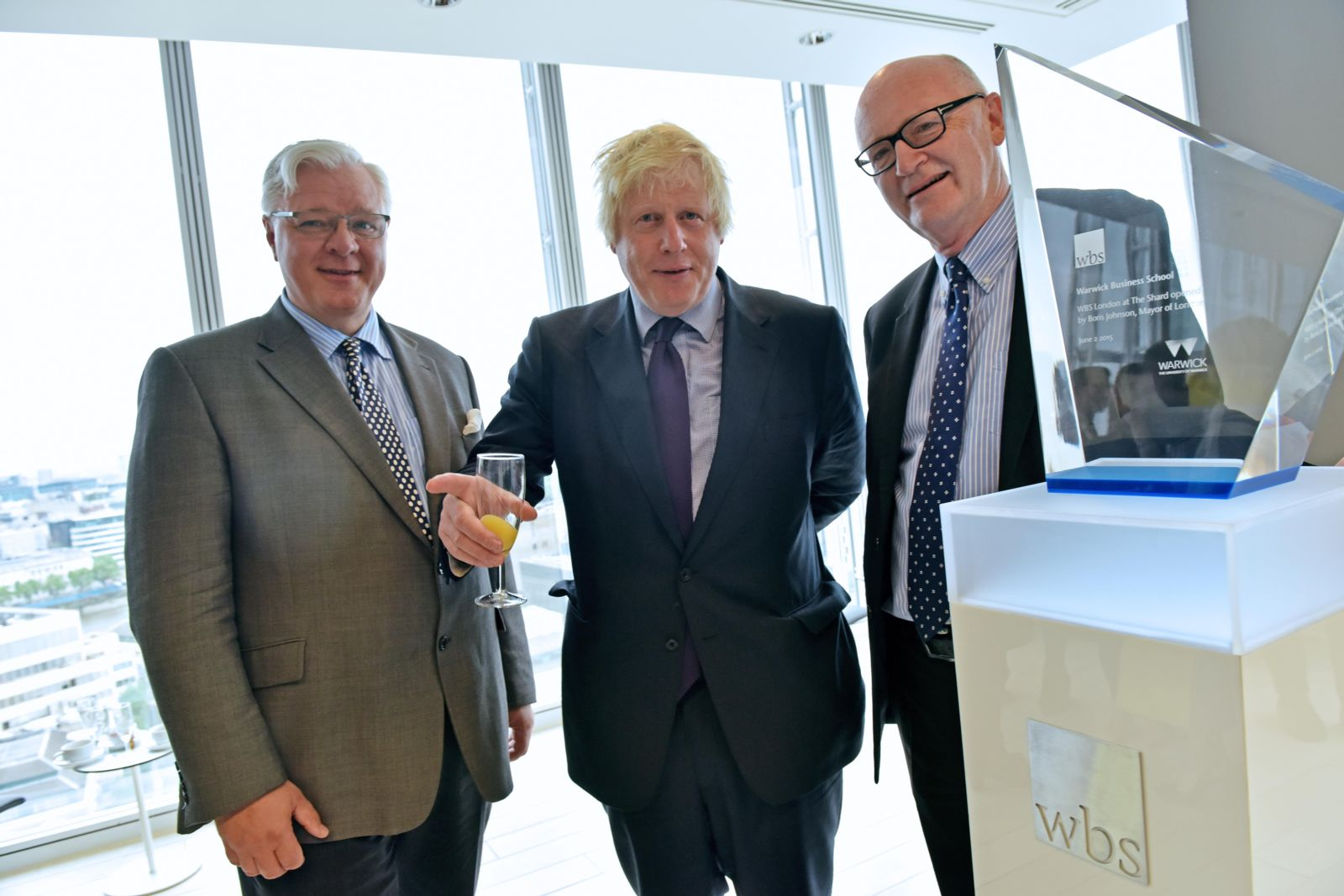 Boris Johnson, Mark Taylor and Nigel Thrift with the glass sculpture at WBS London