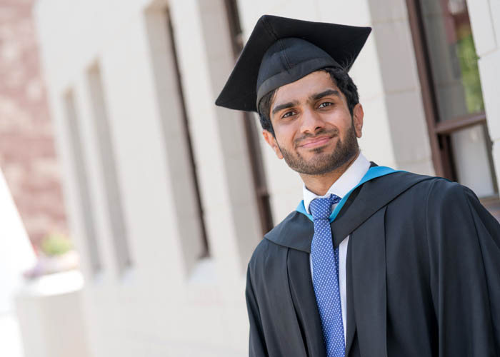 Raiyaan poses on graduation day