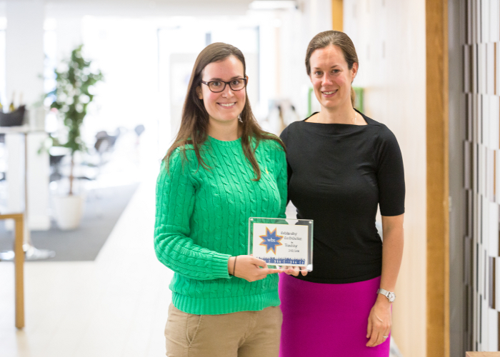 Lauren Schrock pictured collecting WBS teaching award