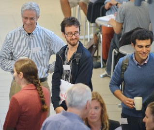Participants and staff mingle at the first WBS Behavioural Science group's Summer School