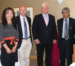 WBS Professors Qing Wang and Geoffrey Wood, WBS Dean Professor Mark Taylor, and Vice Chancellor and Principal of Wits, Adam Habib